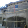 Stucco Scratch coat at rear of West L.A. house, with deep porch off kitchen.